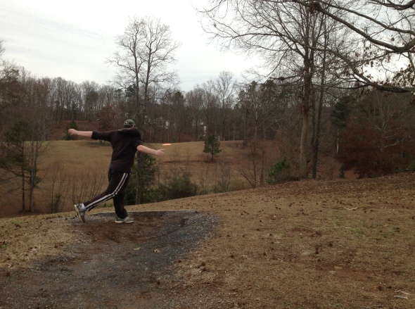 Destin launching a killer drive from atop Hole #8's elevated teebox area. Over the treetops.