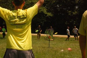 Tournament competitor lands a disc in the basket during the Ring of Fire